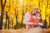 Mother and her baby in the autumn park — Stock Photo
