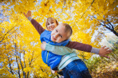 Mother and her kid playing like a plane — Stock Photo