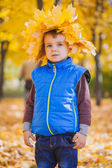 Happy playful boy have fun in the yellow leaves — Stock Photo