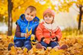 Happy playful children in the autumn park — Stock Photo