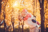 Mother and her baby have fun in the autumn park — Stock Photo
