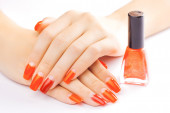 Manicure. applying red nail polish. isolated — Stock Photo