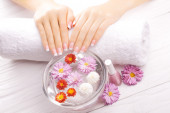 French manicure with colorful chrysanthemum — ストック写真