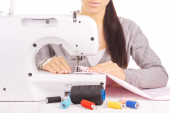 Happy seamstress sewing. isolated on the white — Foto de Stock