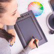 Graphic designer working in office using tablet pen — Stock fotografie #62553973
