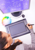 Graphic designer working in office using tablet pen — Stock Photo