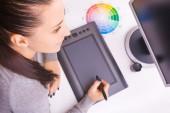 Graphic designer working in office using tablet pen — Foto de Stock