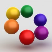 Colorful glossy balls on gray — Stock Photo