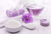 Sea salt and essential oils, purple violet. spa — Stock Photo
