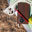 Notebook, compass, apple, rope on stone background — Stock Photo #53459887