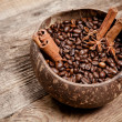 Coffee cup with coffee beans on wooden table — Stock Photo #56073755