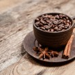 Coffee cup with coffee beans on wooden table — Stock Photo #56076453