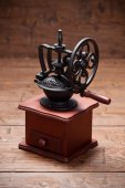 Coffee mill on rustic old wooden table — Stock Photo