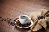 Cup of coffee with beans and spicery — Zdjęcie stockowe