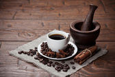 Cup of coffee with beans and spicery — Stockfoto