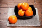 Tangerines on wooden table — Stock Photo
