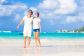 Happy young couple in sunglasses on the beach — Stock Photo