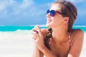 Long haired girl in red swimsuit on tropical caribbean beach — Stock Photo