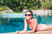 Portrait of beautiful woman in luxury pool — Stock Photo
