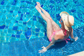 Young beautiful woman in straw hat relaxing in spa pool — Stock Photo