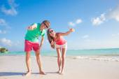 Back view of happy romantic young couple hugging on the beach — Stock Photo