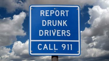 Report Drunk Drivers Sign with Time Lapse Clouds — Stock Video