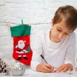 Boy writes a letter to Santa Claus. — Stock Photo #56523833