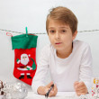 Boy writes a letter to Santa Claus.  — Stock Photo #56524629