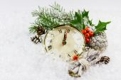 Christmas clock with winter decoration — Stock Photo