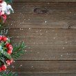 Holly leaves and berries on a wooden background — Stok fotoğraf #56889845