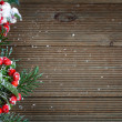 Holly leaves and berries on a wooden background — Stockfoto #56889845