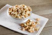 Bowl with cashew on a wooden background — Stock Photo