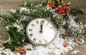 Vintage photo of Christmas clock with winter decoration  — Stock Photo