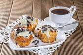 Delicious muffins with chocolate decoration — Stock Photo