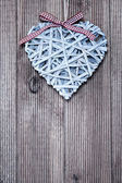 Decorative heart on a wooden background — Fotografia Stock