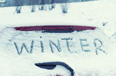 "The inscription ""Winter"" on a car windshield. Toned image.  — Foto de Stock"