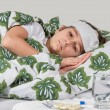 Sick boy lying in bed with high fever — Stock Photo #64504883