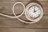 Retro clock on a wooden background — Stock Photo