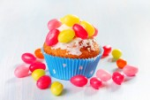 Muffins decorated with colored sugar eggs — Stock Photo