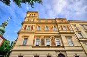 Old tenement house with dramatic sky in Prague - Czech Republic — Stock Photo