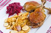 Duck confit with beetroots and jerusalem artichokes fries — Stock Photo