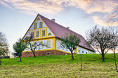 House with little orchard — Stock Photo