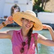 Young woman in hat enjoying vacation time — Stock Photo #63278175
