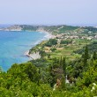 Typical bay with little town Arillas - Corfu, Greece — Stock Photo #64496971