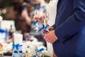 Glasses with champagne in hands  newlyweds — Stock Photo