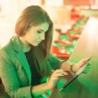 Young woman reading a digital tablet — Stock Photo #70965167