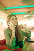 Young woman talking on a cell phone — Stock Photo