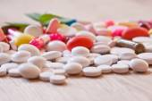 Multicoloured pills and capsules — Stock Photo