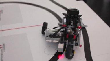 Black plastic mechanical robot on bike — Stock Video