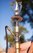 Close-up photo of foil for hookah on nature background — Stock Photo